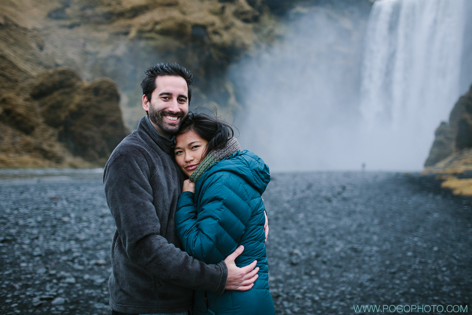 Snuggling at Skogafoss in Iceland