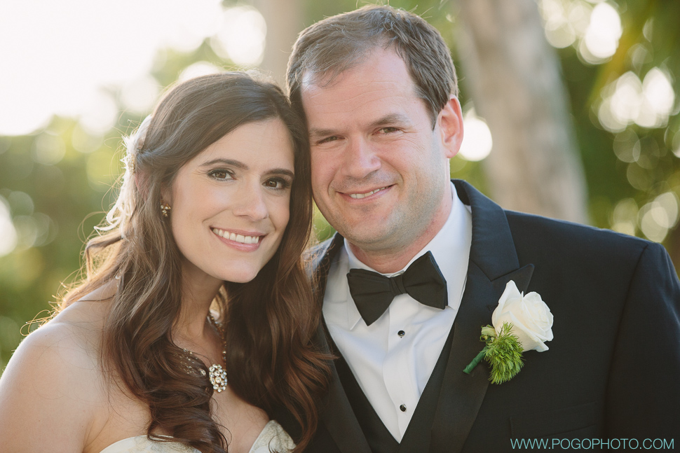 Relaxed, happy wedding couple after the ceremony by Pogo Photo.