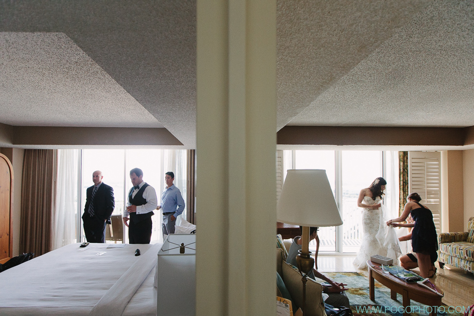 Bride and groom get ready in adjacent rooms (image by Pogo Photo)